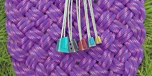 Image of a full set of DMM Alloy Offsets as used by the author, fanned out on a woven rope mat.