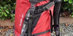 Image of a partially packed Deuter Guide 45+ in red.