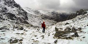 Picture of the author descending a snow dusted and deserted Moel Hebog in western Snowdonia.