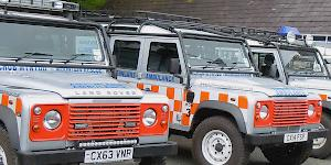 Image of the Llanberis Mountain Rescue Team Landrovers parked up outside of their base in Nant Peris.