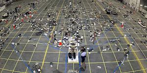 Picture showing the debris from the 2003 Columbia Shuttle disaster laid out in a hangar during investigation.