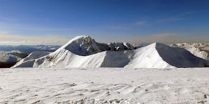 View of Ben Nevis behind the Carn Mor Dearg arete from the summit of Aonach Beag in stunning winter conditions.