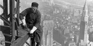 Iconic image of a New York steel worker tightening bolts high above the streets of Manhattan, long before Health and Safety existed.